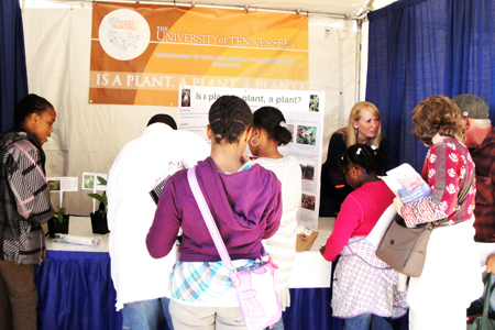 Sarah Wood talks with participants at the USA Science & Engineering Festival.