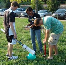 VolsTeach students Jeremy Cason Nobles (left) and Jakob Gulledge (right) shoot air canon as VolsTeach advisor, Jada Johnson (with notebook) observes.