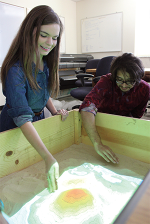 Graduate students Mimi Thomas and Rabby Yasin demonstrate the virtual reality sandbox