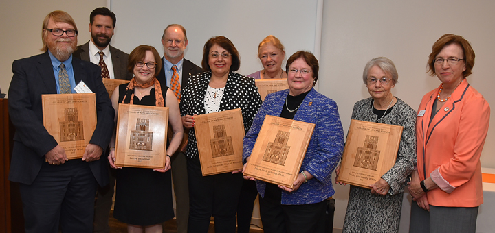 Back row, left to right: Brian Gligor (accepted on behalf of Conrad Ricamora), Wesley W. Diehl, Carol Mayo Jenkins (accepted on behalf of Paula Pell). Front row, left to right: Carroll Van West, Betty Beaumont, Susan Dakak, Diane Grob Schmidt, Sandra White, Dean Theresa M. Lee.