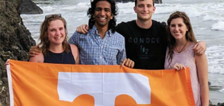 students holding a UT flag in costa rica