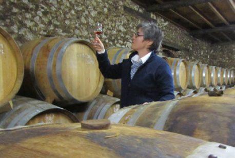 Nancy Fraley inspects distilled spirits