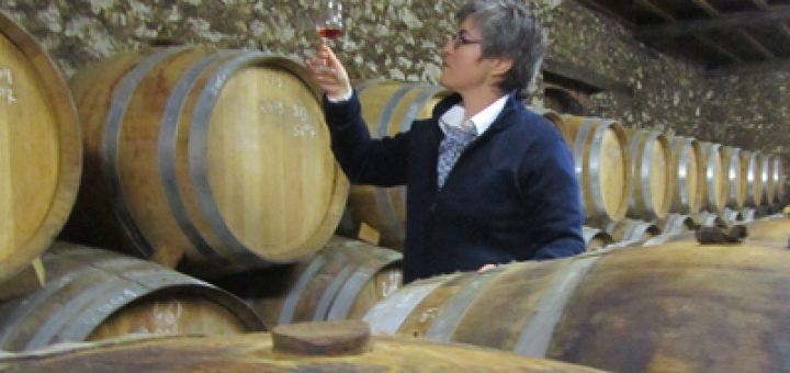 Nancy Fraley inspects distilled spirits