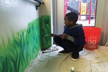 Maynard student painting grass