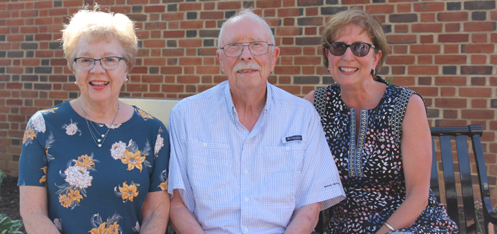 Ginna and Bob Mashburn, along with Bob's daughter Missy Parker, take a seat on the new bench installed in the garden.