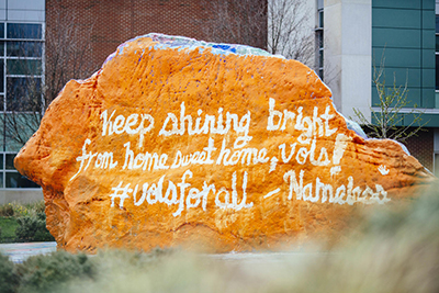 """The Rock message """"Keep shining Bright from home sweet home, Vols! Vols for all - Nameless"""" as campus sits empty during the Coronavirus Pandemic at the University of Tennessee on March 20, 2020 by Hayden Antal/University of Tennessee."""